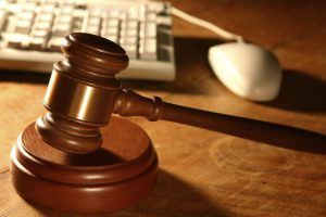 Gavel in front of a keyboard and mouse
